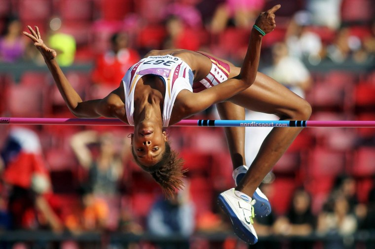 Image: Venezuelan gold medalist Yulimar Rojas leaps during the women's high jump competition at the 10th ODESUR Games