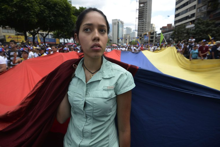 Opposition activists march toward the Cuban embassy to protest against Cuban interference in Venezuela's internal affairs and against the government of President Nicolas Maduro
