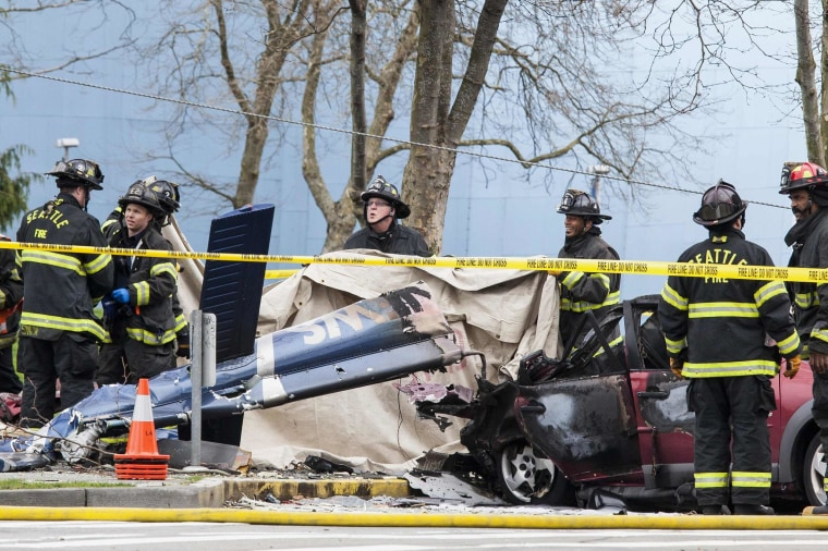 Image: Firefighters investigate the crash of a KOMO News helicopter