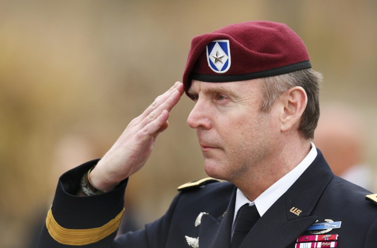 U.S. Army Brigadier General Jeffrey Sinclair salutes as the flag is lowered for the day after leaving the courthouse at Fort Bragg in Fayetteville, North Carolina March 18, 2014.