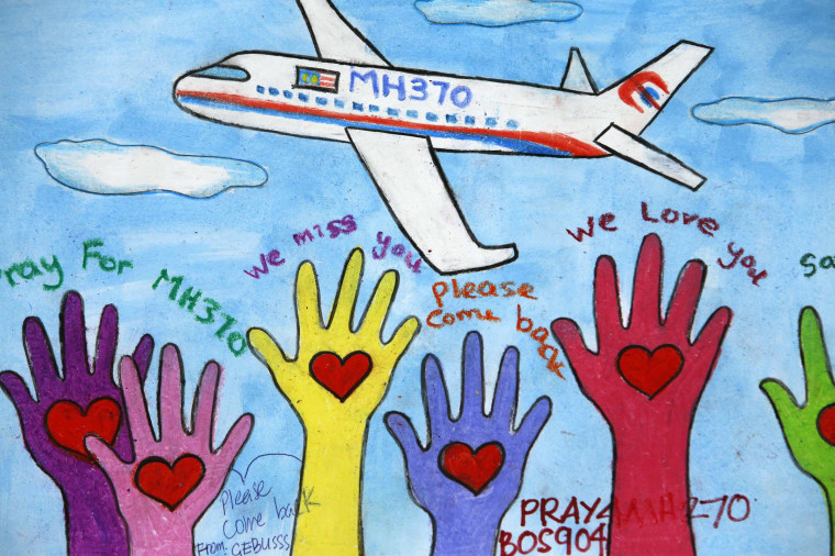 Image: An artwork conveying well-wishes for the missing Malaysia Airlines Flight MH370 is seen in Kuala Lumpur International Airport