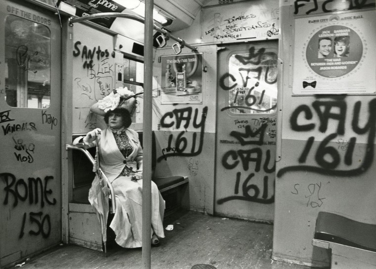 Image: Editta Sherman rides the subway dressed in a Victorian period costume to a photo shoot at the Brooklyn Botanic Garden in 1972.