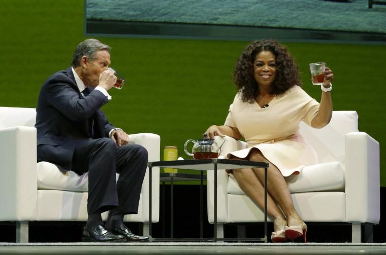 "Image: Howard Schultz and Oprah Winfrey announce \""Oprah Chai\"" in Seattle."