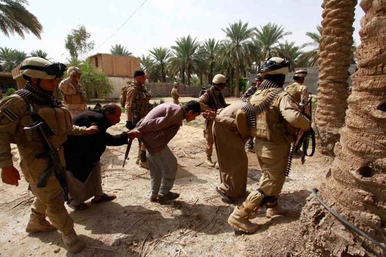 Image: Personnel from Iraqi security forces arrest suspected militants of the al Qaeda-linked Islamic State in Iraq and the Levant (ISIL), during clashes with Iraqi security forces in Jurf al-Sakhar