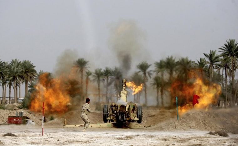 Image: A member of Iraqi security forces fires a cannon during clashes with the al Qaeda-linked Islamic State in Iraq and the Levant (ISIL) in Jurf al-Sakhar