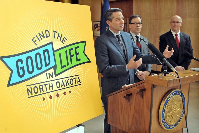 North Dakota Lt. Governor Drew Wrigley at a job recruiting campaign in the state this month. Last week's U.S. jobless claims ticked up, but the trend is going down.