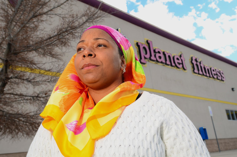 Image: Tarainia McDaniel is photographed in front of Planet Fitness in Albuquerque, N.M.