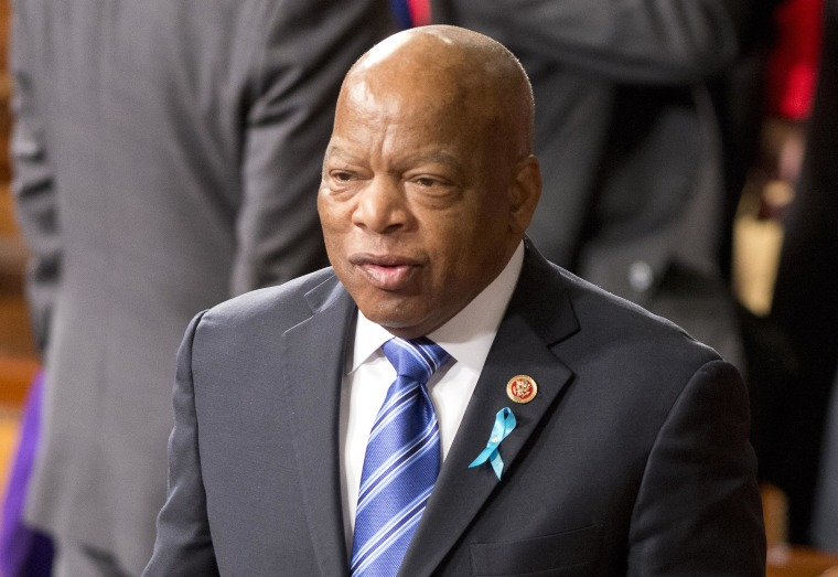 United States Representative John Lewis (Democrat of Georgia) departs the House chamber with a copy of U.S. President Barack Obama's State of the Union Address that was delivered to a Joint Session of Congress in the U.S. Capitol Washington D.C., Jan. 28, 2014.