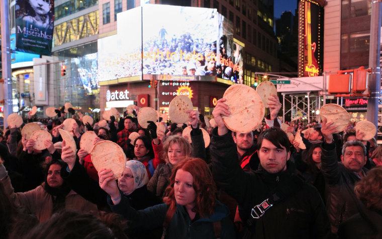 Image: About 75 participants assembled in Times Square on Thursday evening to support the people of Yarmouk