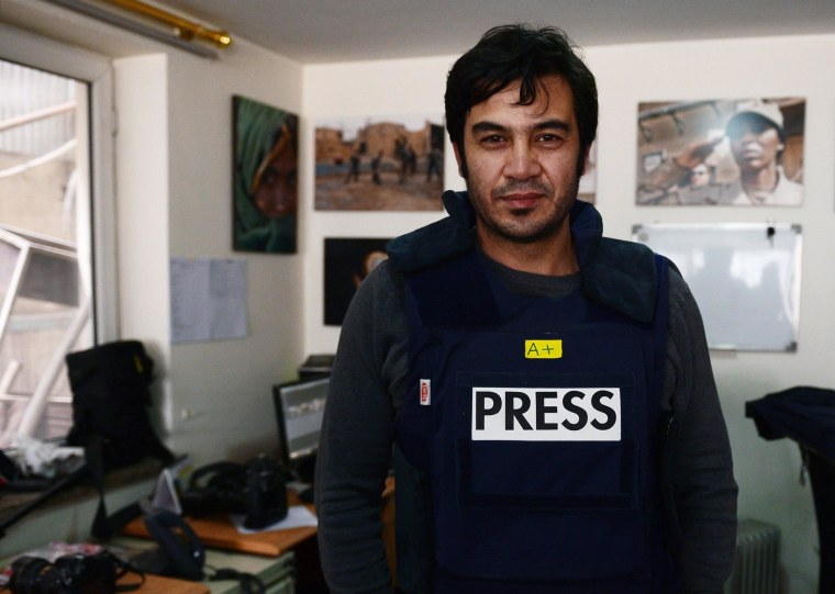 Image: Sardar Ahmad, 40, a staff reporter at the Agence France-Presse (AFP) news agency