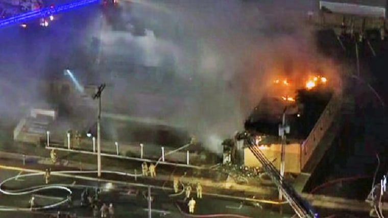 Firefighters work at the scene of a fatal fire at a Jersey shore motel Friday morning.