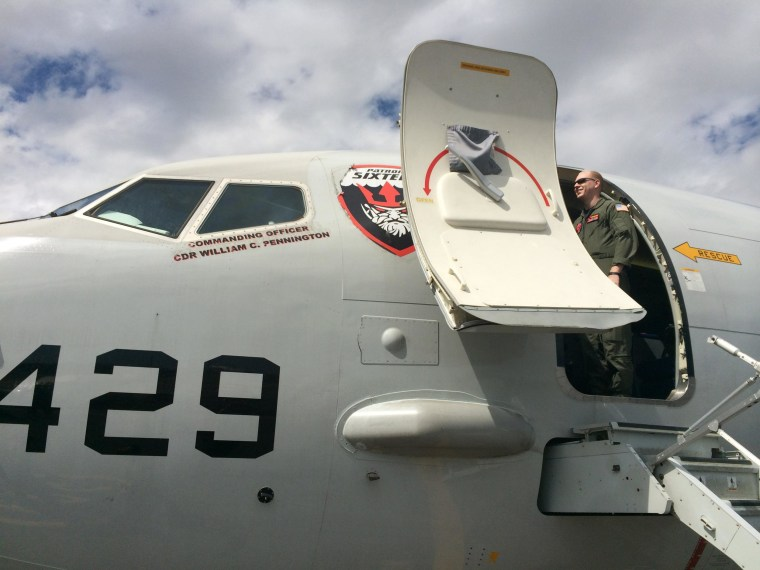 Image: A U.S. Navy P-8 Poseidon plane at the airport in Perth, Australia, on March 21, 2014. The advanced radar aircraft is the primary U.S. military asset assisting in the search for missing Malaysia Airlines flight MH370.