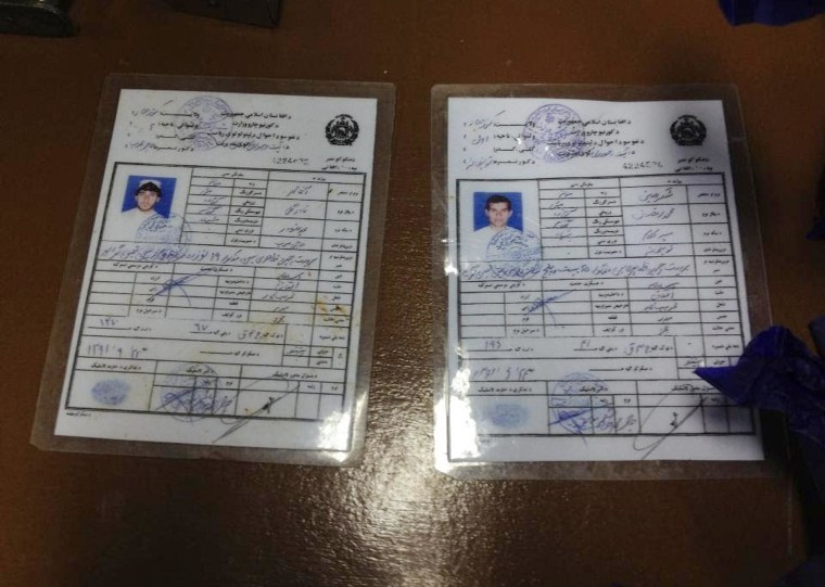 Identity cards of two of the alleged attackers on the Serena Hotel in Kabul were displayed by police
