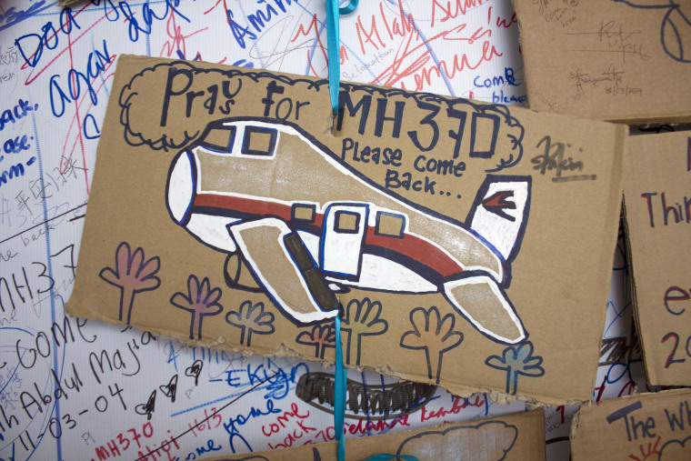 Messages for the passengers aboard missing Malaysia Airlines flight MH370 at the international airport in Kuala Lumpur.