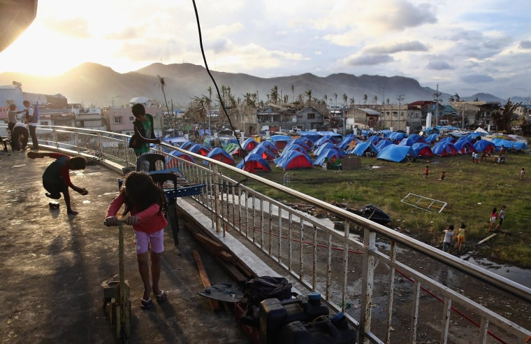 Image: A camp set up near the Astrodome in Tacloban following the typhoon