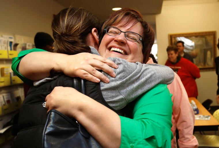 Image: Plaintiff Deboer celebrates with a supporter at the Affirmations Center after a Michigan federal judge ruled that a ban on same-sex marriage violates the U.S. Constitution and must be overturned, in Ferndale