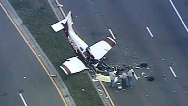 Officials investigate the scene of a single-engine plane crash in Pinellas County, Fla., on March 22, 2014. The pilot was killed and two passengers were injured.