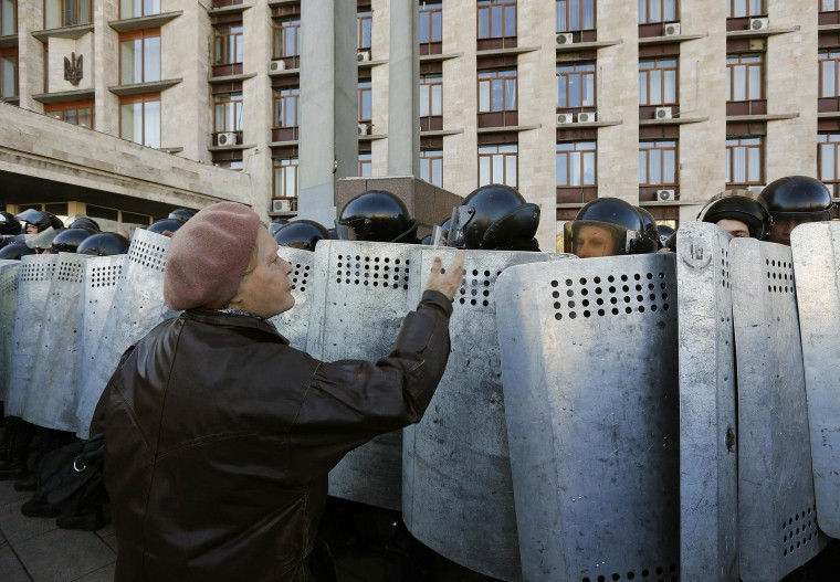 Image: A pro-Russian protester argues with riot policemen in Donetsk
