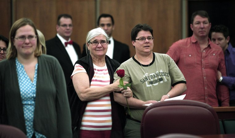 Same-sex couples are married in a group ceremony at the Oakland County Courthouse on Saturday in Pontiac, Mich.