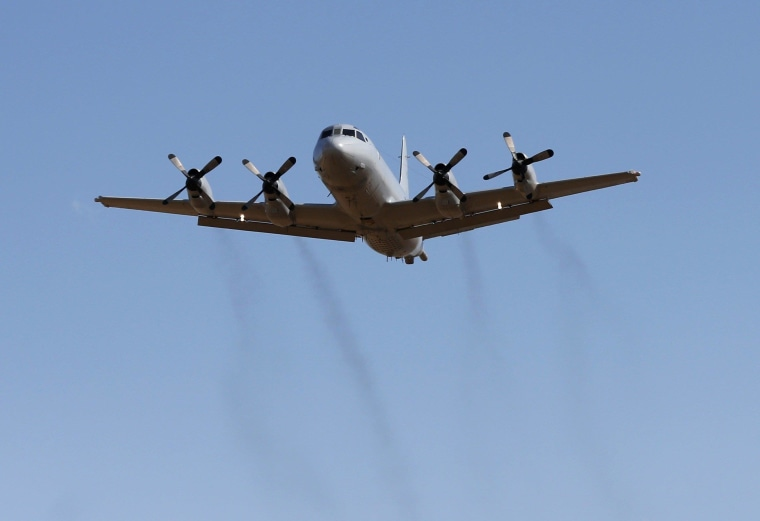 Image: A Royal Australian Air Force P-3 Orion aircraft takes off from RAAF Base Pearce north of Perth