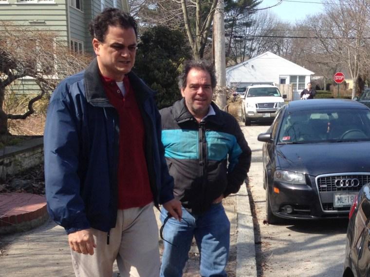 Image: Rhode Island House Speaker Gordon Fox, left, speaks to a reporter