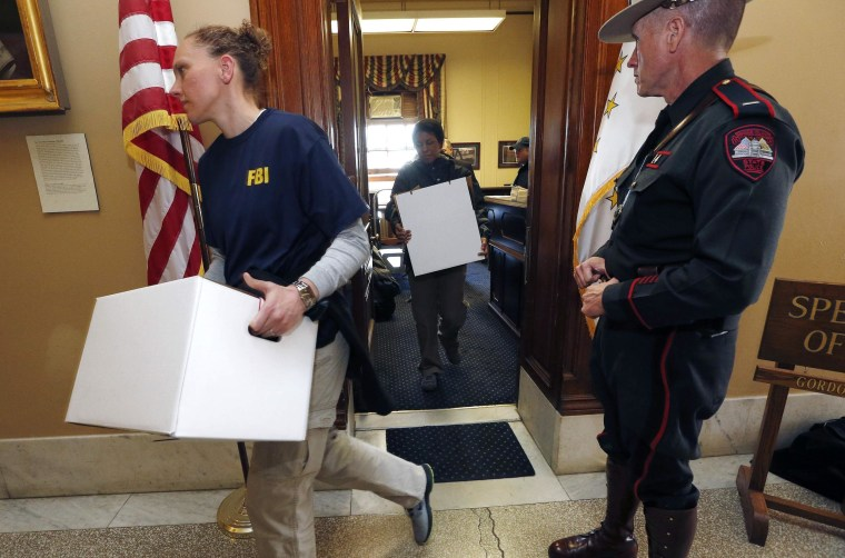 Image: FBI investigators leave the office of Rhode island House Speaker Gordon Fox