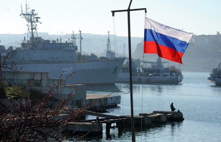 Image: The Russian flag waves in front of the Ukrainian military ship the Slavutich moored in the bay of Sevastopol