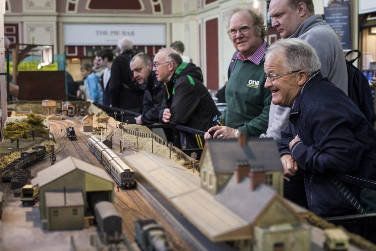 Image: Visitors look at model trains