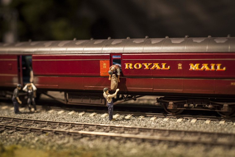 Image: A model railway set depicts the Great Train Robbery in 1963
