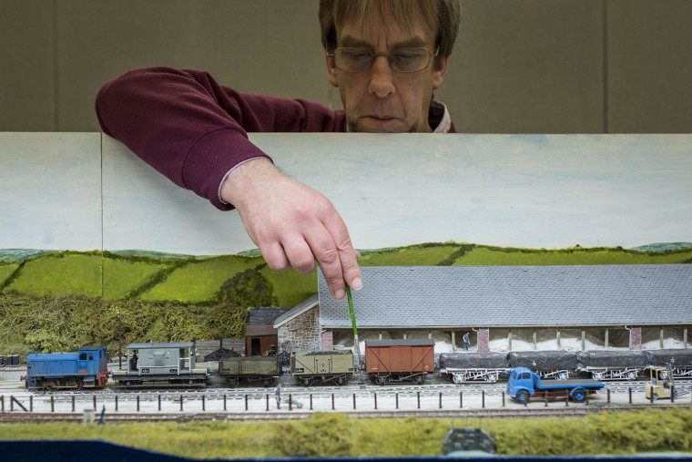 Image: Geoff Sheppard attends to his model railway set