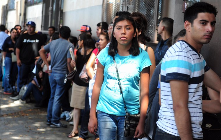 Young people wait in line to enter the offices of the Coalition for Humane Immigrant Rights of Los Angeles (CHIRLA) on August 15, 2012 in Los Angeles, California, on the first day of the Deferred Action for Childhood Arrivals (DACA) program.