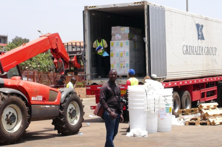 Image: Workers from Doctors Without Borders unload emergency medical supplies to deal with an Ebola outbreak in Conakry