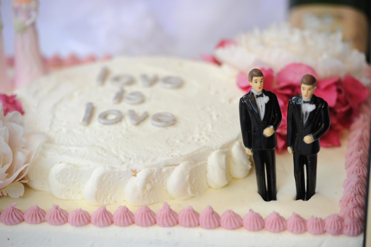 A wedding cake with a male couple