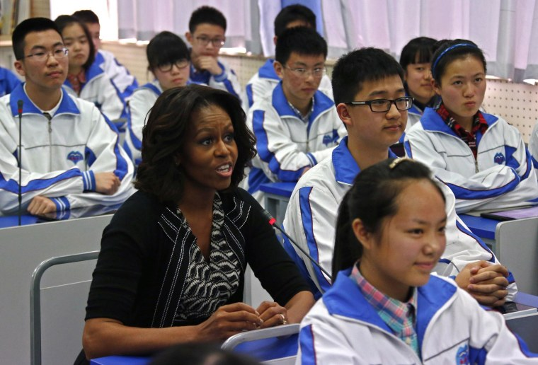Image: U.S. first lady Michelle Obama sits in for an English class with students at Chengdu No. 7 High School in Chengdu