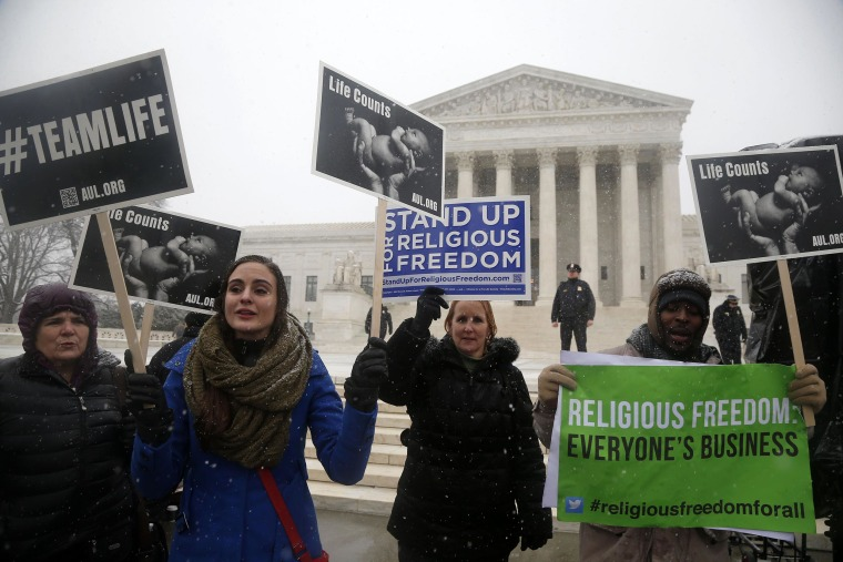Demonstrators in front of the Supreme Court on Tuesday.