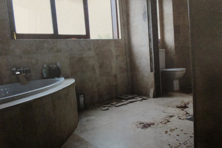 Oscar Pistorius' bathroom three weeks after the Feb. 14, 2013, shooting.  The door through which Pistorius shot Reeva Steenkamp was removed for investigation.