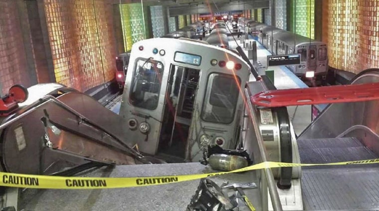 Image: A handout photo shows a derailed commuter train resting on an escalator at O'Hare international airport in Chicago
