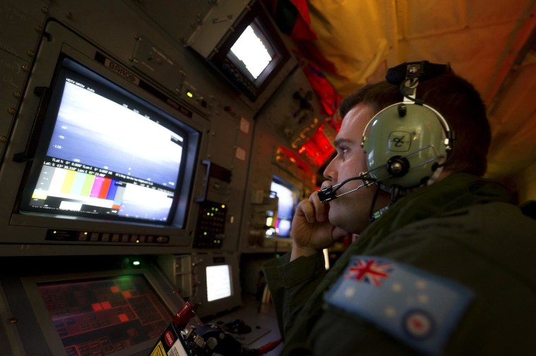 Image: An AAF airborne electronics analyst uses the advanced camera system during the search for missing Malaysian Airlines Flight MH370