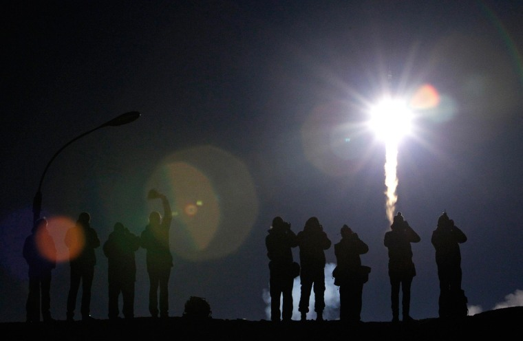 Image: The Soyuz TMA-12M spacecraft carrying the ISS crew of U.S. astronaut Swanson, Russian cosmonauts Skvortsov and Artemyev blasts off from its launch pad at the Baikonur cosmodrome