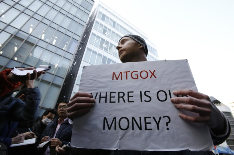 Image: Protester holds a placard against Mt. Gox in Tokyo on Feb. 26