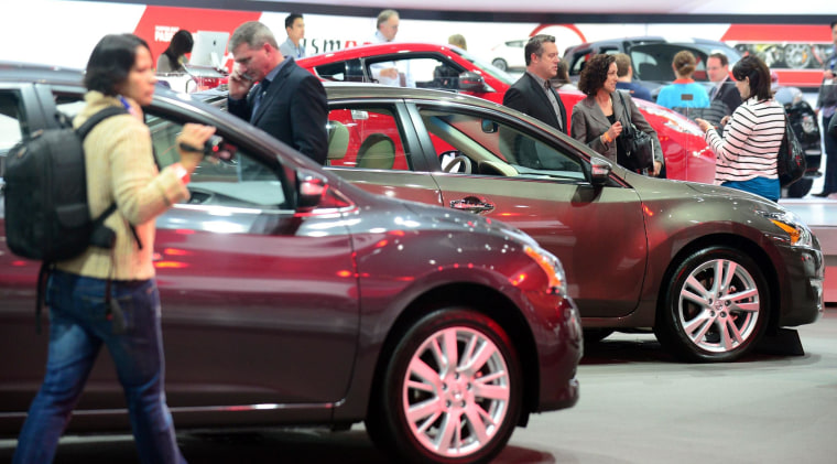 The 2014 Nissan Sentra and Altima are displayed in this Nov. 21, 2013 file photo at the LA Auto Show.