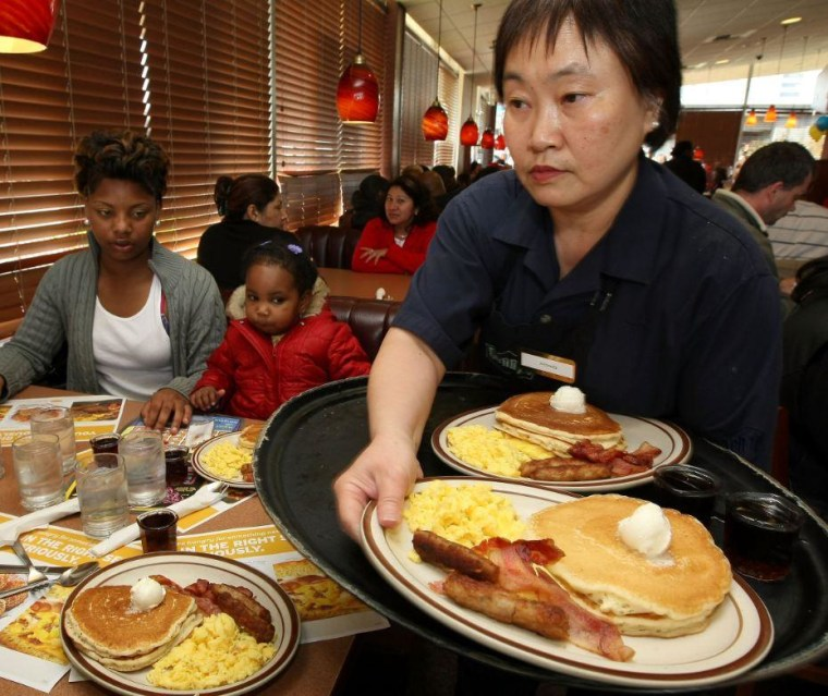 Denny's waiter serves breakfast