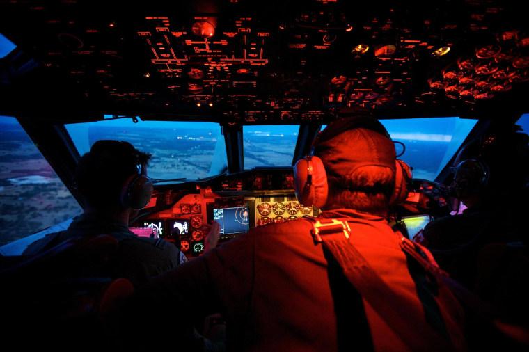 Image: Crew members on board an RAAF AP-3C Orion
