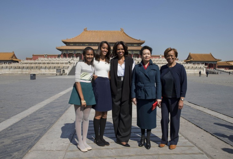 Image: First lady Michelle Obama and her daughters, from left, Sasha and Malia, her mother Marian Robinson and Peng Liyuan, wife of Chinese President Xi Jinping