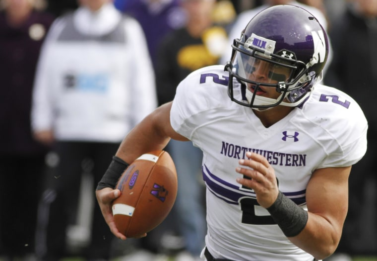 Image: Quarterback Kain Colter #2 of the Northwestern Wildcats scrambles on a keeper in the second quarter against the Iowa Hawkeyes