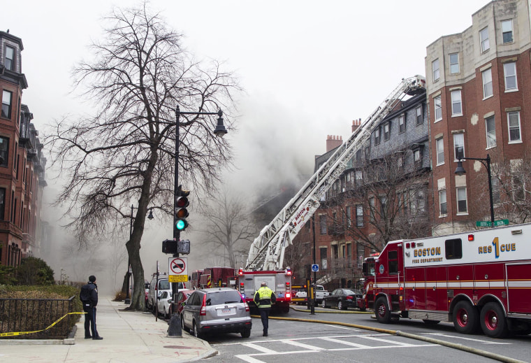 Image: Firefighters fight a multi-alarm fire at a four-story brownstone in the Back Bay neighborhood near the Charles River