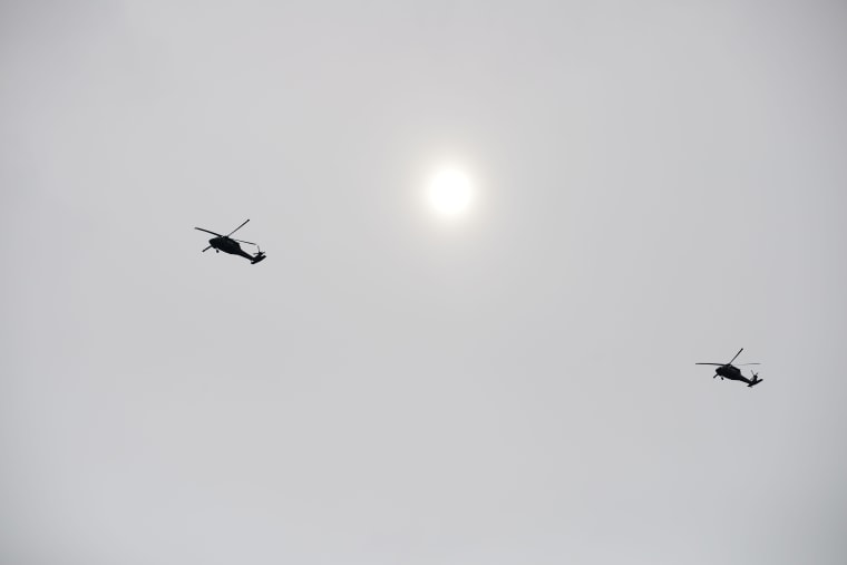 Helicopters flying over Oso on Wednesday heading for the disaster scene.