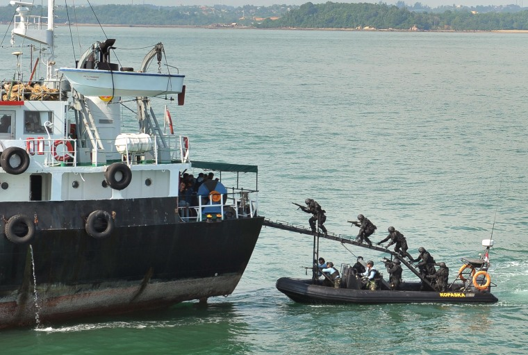 "Image: Indonesian naval forces storm the ""hijacked"" MT Promise in May 2012"