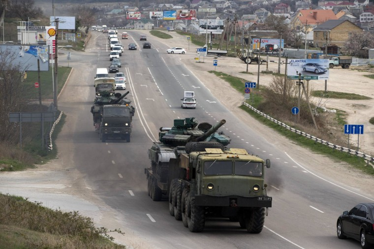 Ukrainian tanks are transported from their base in Perevalne, outside Simferopol, Crimea.