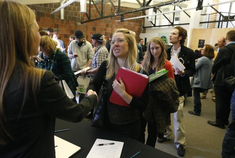 Job seekers attend a marijuana industry job fair hosted by Open Vape, a vaporizer company, in Downtown Denver.